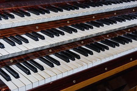 Pipe organ keyboards closeup view (selective focus).