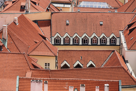 old red roofs with dormers from the air in Old town Prague