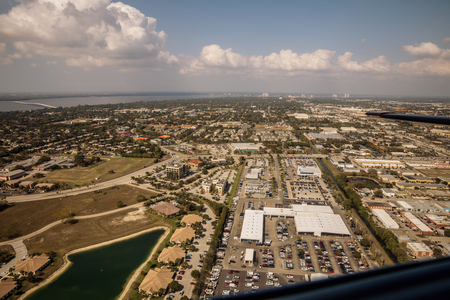 Aerial view of the metropolis Fort Myers and Cape Coral in south Florida. Typical houses with swamps and access across the channel to the sea. Florida. USA