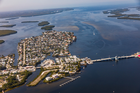 An aerial view of the historic Florida town Matlacha and bridge connecting by bridge with Pine Island with Cape Coral. Florida Zdjęcie Seryjne - 85625856