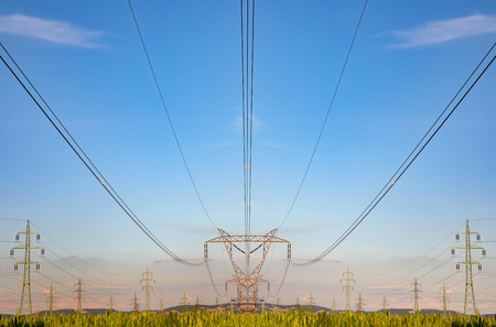 High voltage pylon on skies background, Transmission line tower in countryside Archivio Fotografico
