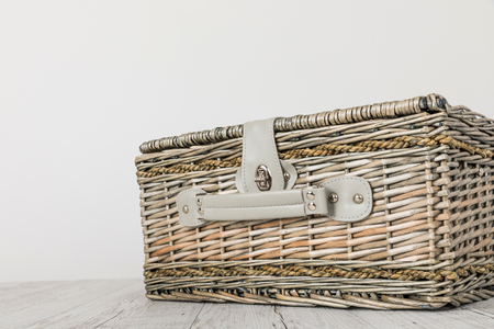 picnic basket and table place on white background Archivio Fotografico