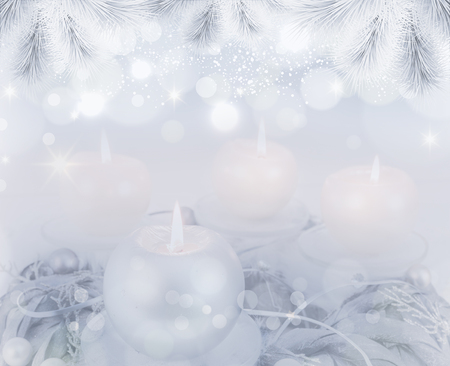 Silver advent wreath with 4 metallic candles on blue backround
