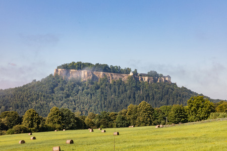 Germany. Saxon Switzerland. Fortress of Koenigstein in summer day. Fortress wall of German castle Konigstein Zdjęcie Seryjne - 84239013