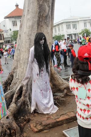 dutch girl: Jakarta, Indonesia - December 17 2015 : Kuntilanak, Pontianak - female vampiric ghost in Old Town Jakarta Editorial