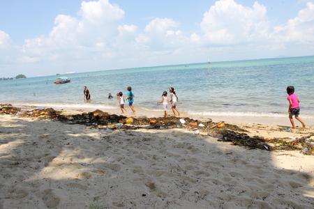 Riau Islands, Batam, Indonesia -  January 10 2016 : Kids, children playing in trash on a beach Redakční