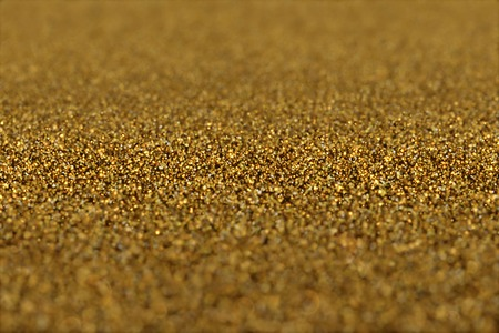 Abstract Glamour Background of Glitter Golden Particles.