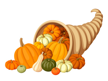 Autumn cornucopia (horn of plenty) with pumpkins.