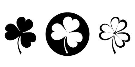 Vector set of three black silhouettes of clovers shamrock. Vettoriali