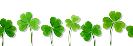Vector horizontal seamless background with green clover leaves shamrock on a white background. Stock Illustratie