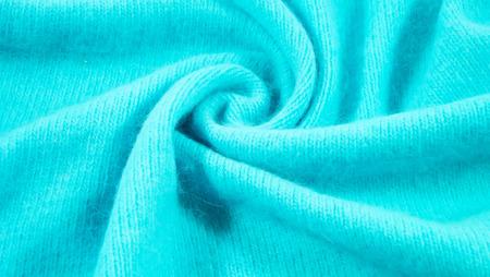 Beautiful knitted background of blue yarn. Stock Photo