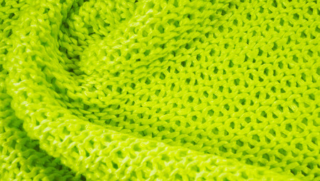 Beautiful knitted background of green yarn. Stock Photo
