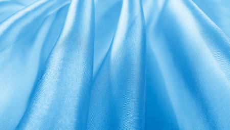Beautiful blue background of light fabric. Abstract background.