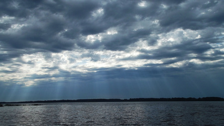 The suns rays make their way through the clouds.
