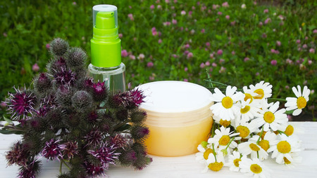 Cosmetic products based on burdock and chamomile.