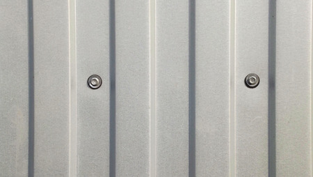 The gray wall of the metal profile.Abstract background.