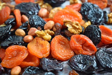Dried fruits and nuts on wooden background.Healthy. Banque d'images