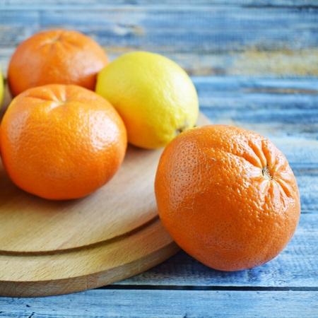 Tasty and healthy vegetables. Fresh tangerines and lemons. Vegetarian food.