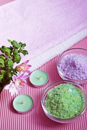 Colorful bath salt on pink background. Healthy skin care.