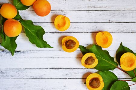 Ripe, sweet apricots on a wooden background.Healthy fruit.