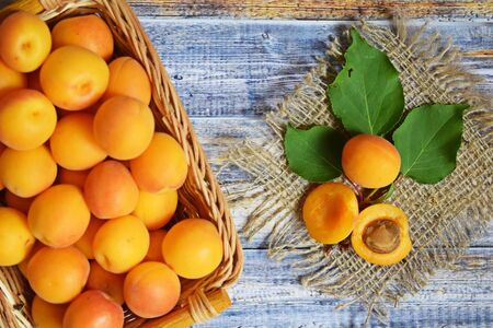 Ripe, sweet apricots on a wooden background.Healthy fruit. Stock fotó