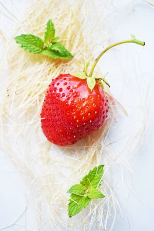 Ripe, sweet strawberry on white background.