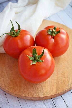 Delicious, ripe tomatoes on a wooden background.Healthy diet.
