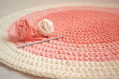 Round pink handmade rug.Crocheting from knitted yarn.