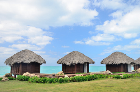 bungalows: Bungalows in front of turquoise sea. Stock Photo