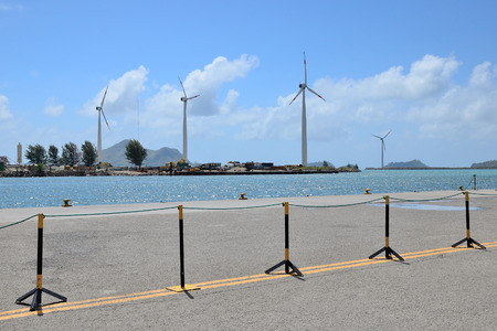 Group of windmills for electric energy production in the port of Seychelles.