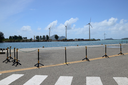 pawl: Group of windmills for electric energy production in the port of Seychelles.
