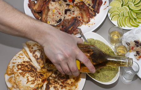 bean family: Mexican party. tequila and traditional Mexican dishes on the table