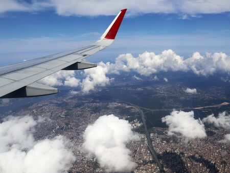 View of Istanbul from window of airplane, Turkey. View through porthole of aircraft on the wing of aircraft, clouds, blue sky and the Earth. Standard-Bild