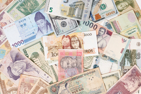 many different currencies as colorful background concept global money Reklamní fotografie