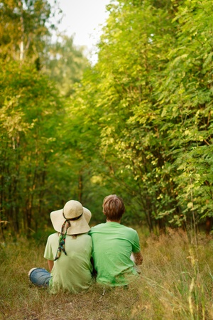 relaxation of young couple in the forest  photo
