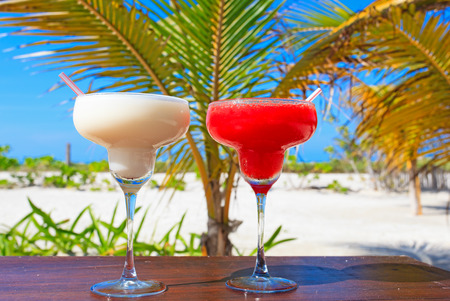 caribbean drink: Two cocktails on luxury tropical sand beach Stock Photo