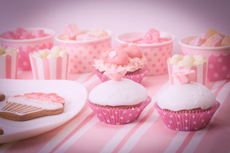 girlie: dessert table in pink at girls birthday party