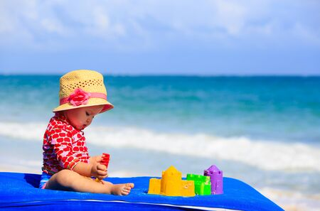 little girl swimsuit: cute little girl  with sand toys on summer beach