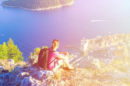 tourist enjoying scenic view hiking in mountains of Croatia, Europe photo
