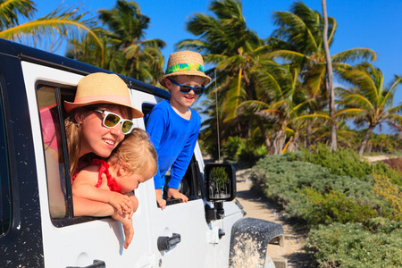off road vehicle: family driving off-road car on tropical beach, vacation concept