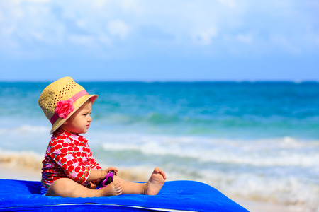 cute little girl on summer tropical beach