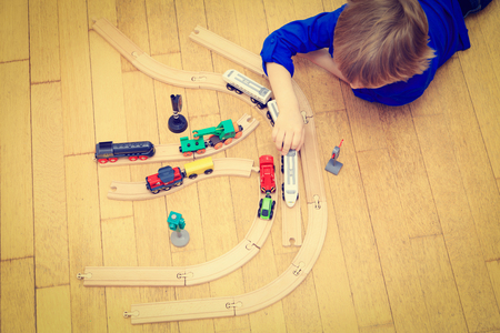 kids studying: child playing with trains indoor, early learning Stock Photo