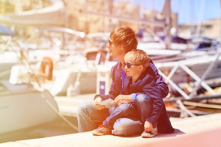 malta map: father and little son looking at map in the port of Malta