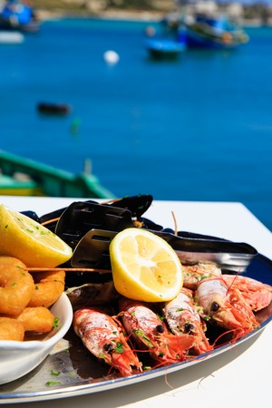 seafood platter: Seafood platter served in mediterranean restaurant against the sea