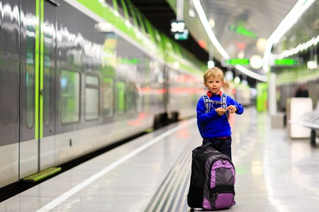u bahn: little boy waiting for the train on tube platform, kids travel Stock Photo