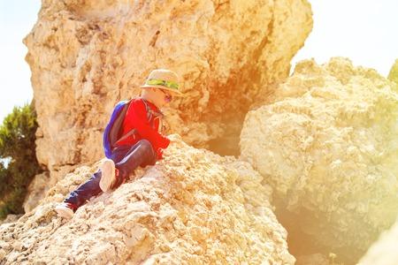 little boy climbing in mountains, kids sport photo