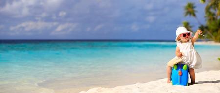 baby clothing: cute little girl travel on summer beach, kids travel