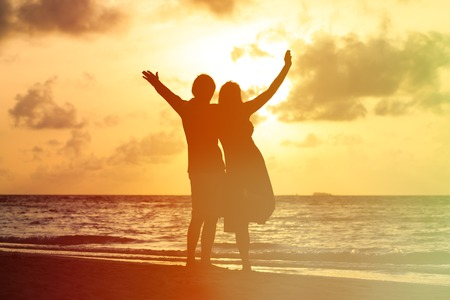 wedding couple: Happy young romantic couple on the beach at sunset Stock Photo