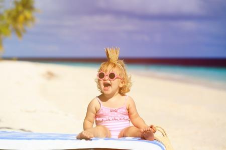beach girl: cute little baby princess on summer tropical beach