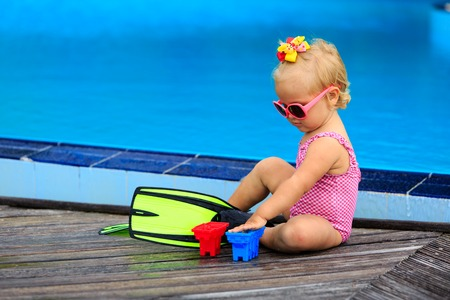 flippers: cute girl with flippers in swimming pool at tropical beach Stock Photo